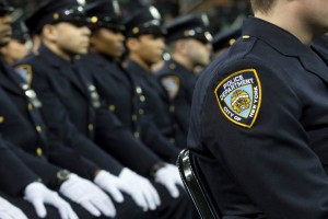 New recruits attend their New York Police Academy graduation ceremony, Monday Dec. 29, 2014, at Madison Square Garden in New York. Nearly 1000 officers were sworn in as tensions between city hall and the NYPD continued following the Dec. 20 shooting deaths of officers Rafael Ramos and Wenjian Liu. (AP Photo/John Minchillo)